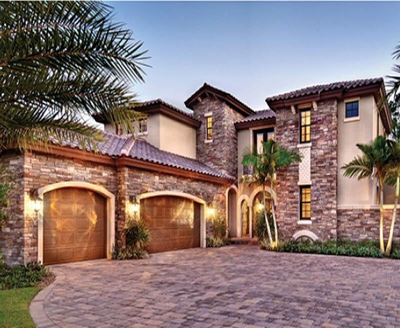 Terracotta barrel roof tiles and stone accents enhance for Southern custom homes